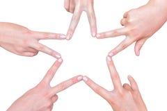 Ręki dziewczyny robi gwiazdowemu kształtowi na bielu Obrazy Royalty Free