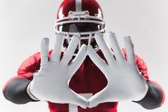 Ręki futbolu amerykańskiego gracz na bielu Obraz Royalty Free