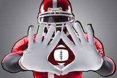Ręki futbolu amerykańskiego gracz na bielu Zdjęcie Stock
