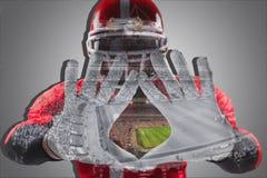 Ręki futbolu amerykańskiego gracz na bielu Zdjęcia Stock