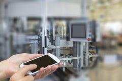 Ręki i mądrze telefon w przemysłu wnętrzu Obrazy Stock