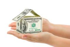 Ręki i pieniądze dom obraz royalty free