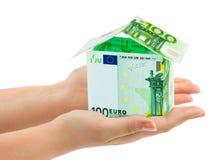 Ręki i pieniądze dom obraz stock