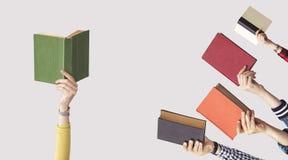 Ręki ludzie chwyt książek Obraz Stock