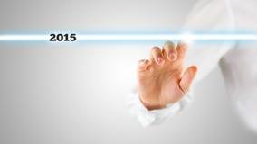 Ręki macania ekran z Podkreślający 2015 Fotografia Royalty Free