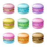 Ręki malujący kolorowi macarons Zdjęcia Stock