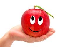 Ręki mienia czerwony jabłko odizolowywający na bielu Zdjęcie Royalty Free