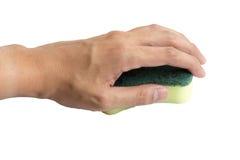 Ręki mienia gąbka na odosobnionym białym tle fotografia stock