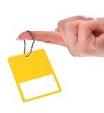 ręki mienia metki kolor żółty Zdjęcia Stock