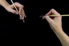 Ręki mienia muśnięcie, ustawia odosobnionego na czerni Zdjęcia Royalty Free