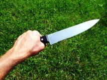 ręki mienia nóż tęsk Zdjęcie Royalty Free
