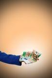 ręki mienia pieniądze szeroko rozpościerać Obraz Royalty Free