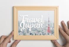 Ręki mienia podróży Japan Tokio fotografii plakatowa rama Fotografia Stock