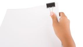 Ręki mienia segregatoru klamerka III I Biały papier Obrazy Stock