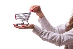 Ręki mienia wózek na zakupy odizolowywający na bielu Obraz Royalty Free