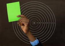 Ręki mienia zielona karta przed okręgu promieniomierza liczbami Zdjęcie Royalty Free