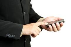 Ręki mienie i mądrze dotyka telefon Zdjęcie Royalty Free