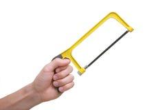 ręki mienie odizolowywał narzędziowego saw kolor żółty Zdjęcie Stock