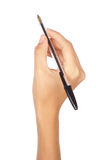 ręki mienie odizolowywający nad pióra biel Zdjęcie Stock