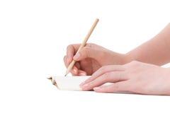 Ręki pióra writing odizolowywający na białym tle zdjęcie stock