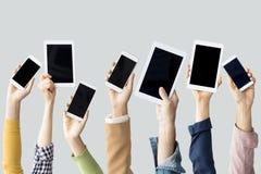 Ręki podnosi technologicznych przyrząda zdjęcia royalty free