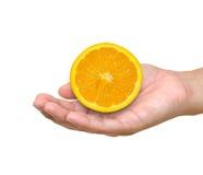 ręki pomarańcze Zdjęcia Stock