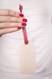 Ręki trzyma boże narodzenie ornament Zdjęcia Stock
