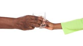 Ręki trzyma szkło Fotografia Stock