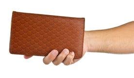 Ręki trzymają notatnika na bielu Obrazy Stock