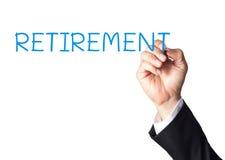 ręki writing emerytura na białej desce obrazy stock