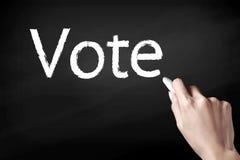 Ręki writing głosowanie Zdjęcia Stock