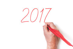 2017 ręki writing liczb czerwieni piórko na białym tle Fotografia Royalty Free