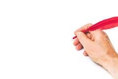 2017 ręki writing liczb czerwieni piórko na białym tle Obrazy Royalty Free