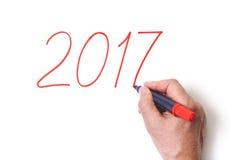 2017 Ręki writing liczy czerwonego markiera na białym tle Obraz Stock