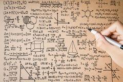 Ręki writing matematyki formuła Zdjęcia Stock
