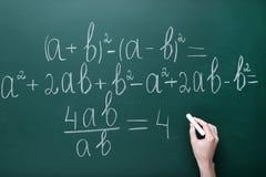Ręki writing maths formuły zdjęcie royalty free