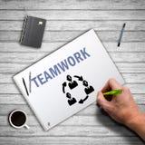 Ręki writing praca zespołowa na kanwie Obrazy Stock