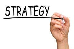Ręki writing słowa strategia Zdjęcie Stock