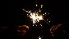 Ręki z płonącymi sparklers w ciemności zbiory