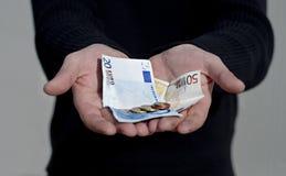 Ręki z pieniądze Zdjęcia Stock