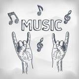 Ręki z skała podnoszącymi palcami Wpisowa muzyka Obrazy Stock