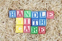 Rękojeść Z Opieką Literującą Literować Blokiem Obraz Royalty Free