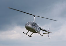 R-44 hovers Stock Photo
