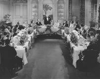 宴会桌(所有人被描述不更长生存,并且庄园不存在 供应商保单将没有模型r 免版税库存照片