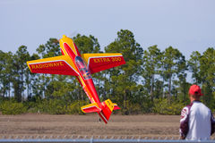 An R/C model practicing stunts. Cape Coral, Fl - February 22: Alex Miller the owner/pilot practices a tail stand during a practice session for the Gathering of Stock Photo