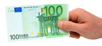 ręce 100 euro gospodarstwa Obrazy Stock