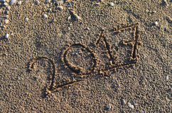 2017 ręcznie pisany w piasku Fotografia Stock