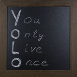 Ręcznie pisany YOLO na blackboard Zdjęcie Stock