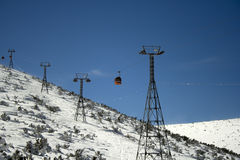 Rеd cabin lift. In Bulgarian mountains with blue sky as a background Stock Photo