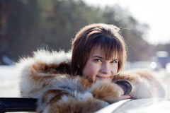 R female driver with her  car Royalty Free Stock Photo